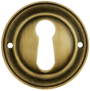 Round Stamped Brass Keyhole Cover In Antique By Hand