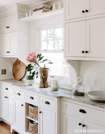 vintage style kitchen cabinets with bronze hardware
