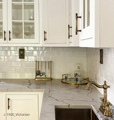 Kitchen cabinets with classical revival drawer pulls in Antique-by-Hand