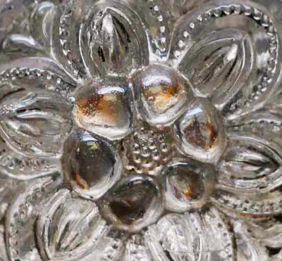 Detail of early floral sandwich glass dresser knob